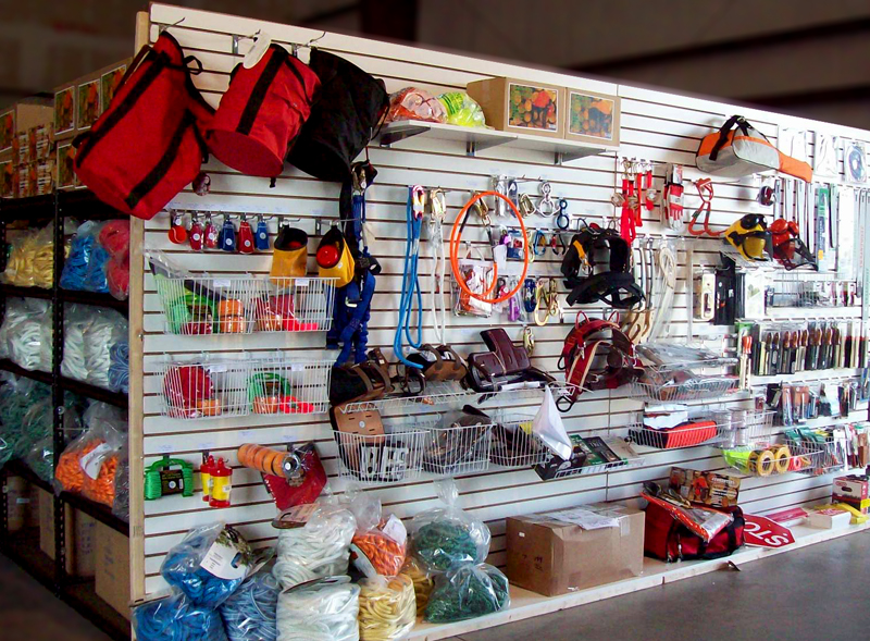 Picture of a typical tree gear dealer showroom showing arborist ropes, saws, and other tree gear on a slat wall with good backup inventory.